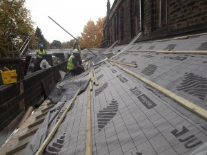 Insulation being fitted, ready for the slates to be refixed